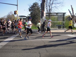 Runners turning on the Mississauga Road from Burnhamthorpe