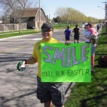 Holding the sign and cheering around the 26km mark of the Mississauga Marathon
