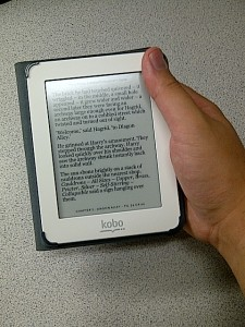My large, manly hand dwarfing the Kobo Mini eReader