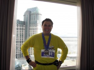 Posing with medal back in the hotel room after the Niagara Half-Marathon