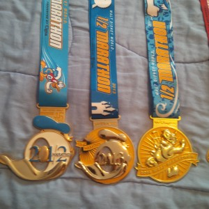 Walt Disney World Half-Marathon Medals from 2012, 2013, and 2014