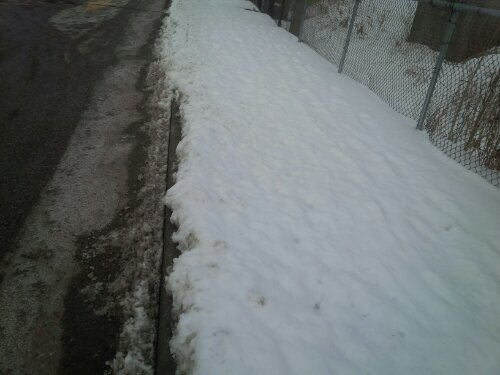 Exhibit B: Completely uncleared sidewalk, 10-15cm deep snow. Note the tauntingly clear roadway to the left.