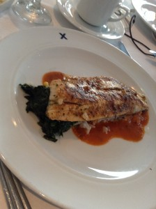 Fish over rice and spinach