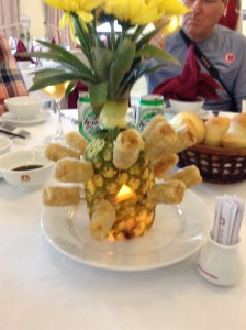 Very creative use of a hollowed-out pineapple to hold spring rolls