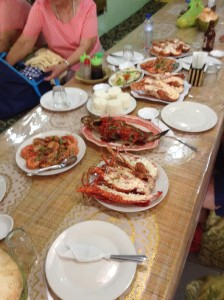 There are at least 6 lobster on the table...