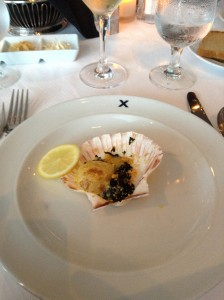 Scallop presented in a shell
