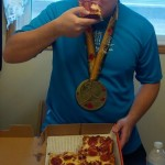 Celebrating finishing the Goodlife Fitness Toronto Marathon with an epic cheat meal: Deep dish pizza with bacon-wrapped crust