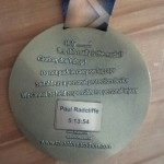 Back of my Goodlife Fitness Toronto Marathon  medal with the iTab showing my disappointing time