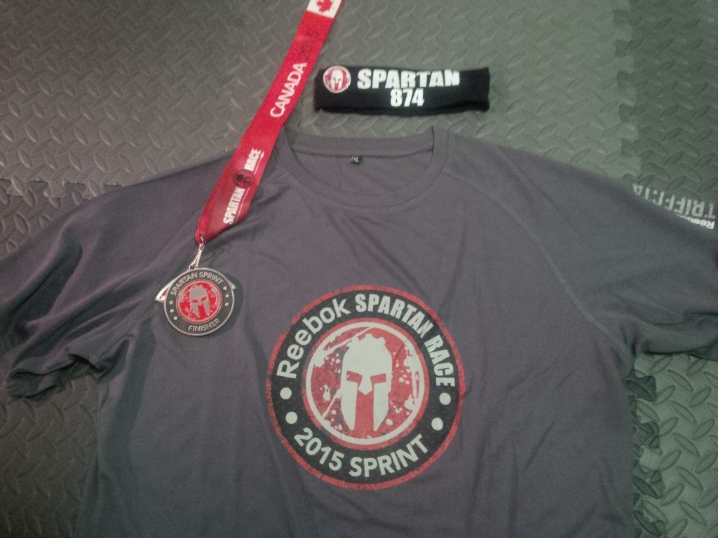 Medal, shirt, and headband from the Toronto Sprint Spartan Race. The ribbon from the medal is even rather muddy because I put it on right after finishing the race.