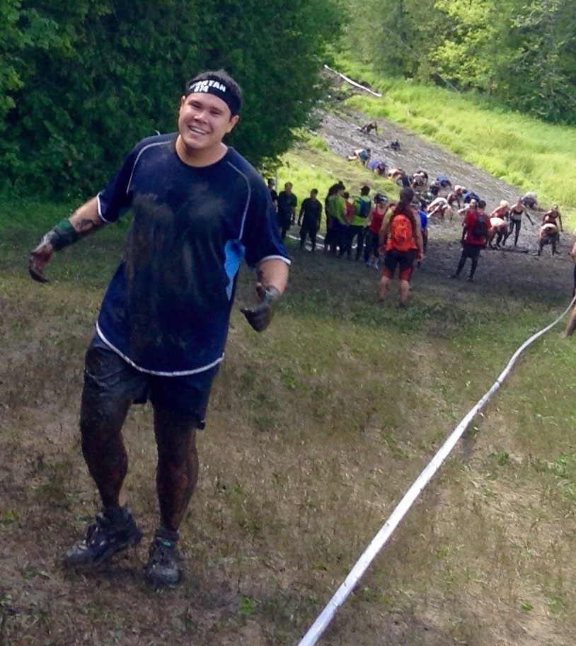 Climbing a hill covered in mud at the Toronto Sprint Spartan Race