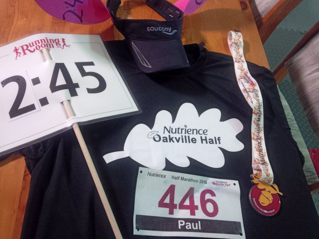 Medal, race shirt, and I still have my pacer sign after the Oakville Half-Marathon 2015