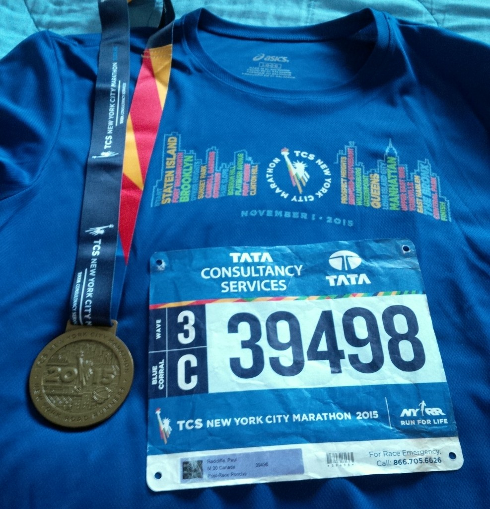 Medal, race shirt, and my race bib