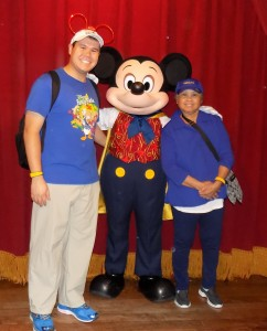 My mom and I with Mickey Mouse