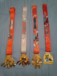Four years of Goofy Challenge Medals (2012, 2013, 2014, 2016)