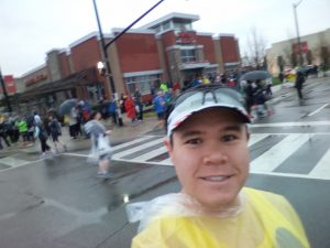 Pre-race selfie wearing my poncho in the intersection of Square One Drive and City Centre Drive