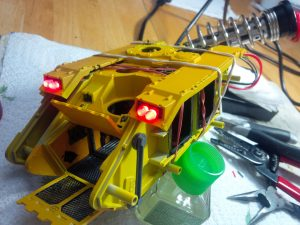 """Work in progress on a big yellow tank with lights called a """"Land Raider"""""""