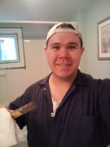 Playing handyman. In this particular picture, painter.