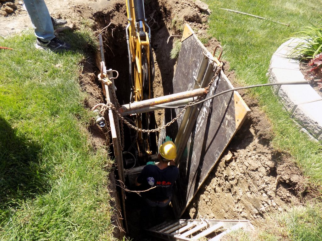 Very large hole in the ground to fix the pipe. Might as well have filled it with money afterwards...