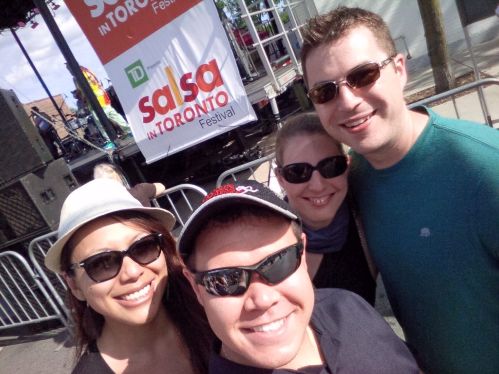 A particularly appropriate place for a Salsa on St. Clair Selfie: (L-R) Sharise, myself, Caroline, and Marcus
