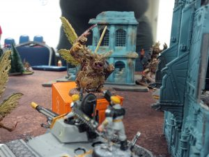 One of my Warhammer 40k tanks staring down an oncoming daemon