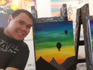 Posing with my hot air balloon painting