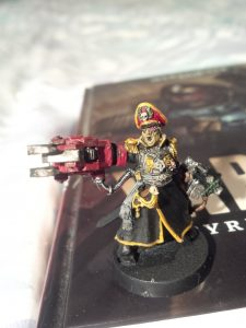I painted a miniature character model of Commissar Sebastian Yarrick, the main character from the aforementioned book