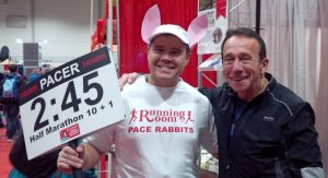 Posing in my pacer outfit with John Stanton at the expo of the Scotiabank Toronto Waterfront Marathon expo