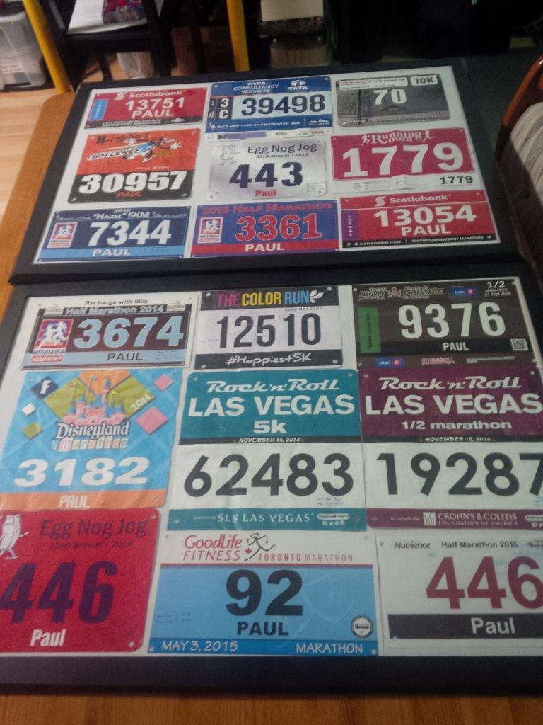 About two years of Race Bibs framed.